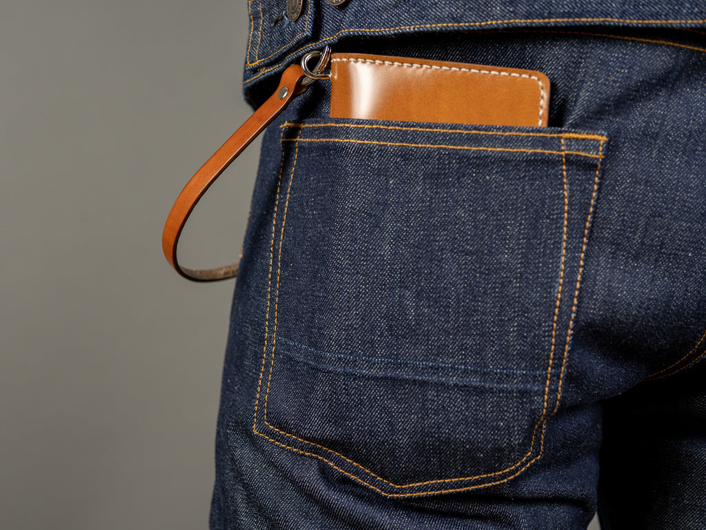 tanuki shell cordovan long bifold wallet in back pocket