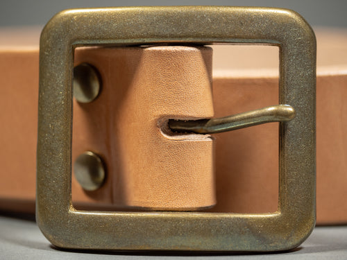 the strike gold belt cowhide leather tan brass buckle