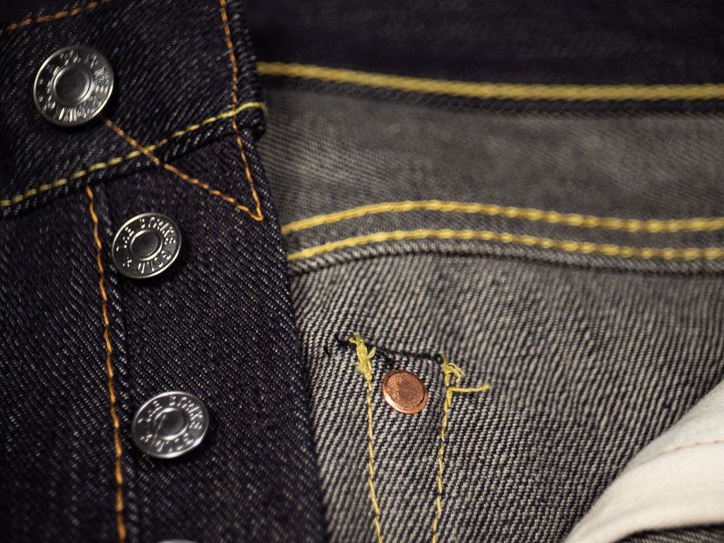 the strike gold 3109 left hand twill raw japanese jeans buttons