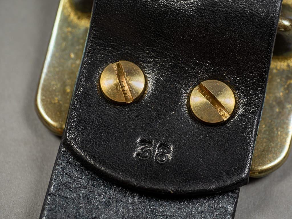The Strike Gold Leather Belt Black resistant brass