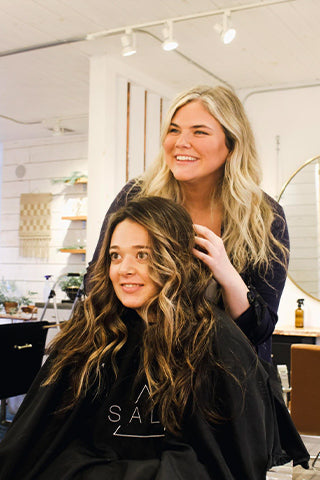 hairstylist with client