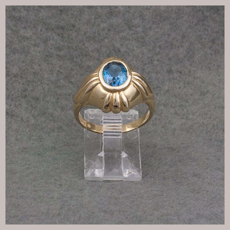 Oval Bezel Set Topaz Ring