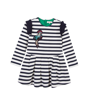 Catimini CM30305 Striped Dress With Bird Motif  Navy and ivory breton stripe dress, featuring navy pleated ruffles to the shoulder and an embroidered exotic bird to the front. This jersey dress offers both comfort and style.  Features:  85% cotton, 11% polyamide, 2% elastane, 1% polyester  Lining: 100% cotton Machine washable at 30C Concealed zip fastening to the back