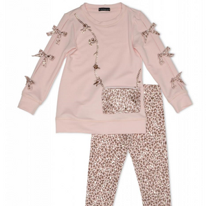 Kate Mack Pink Tunic And Legging Set With Purse Detail  Pink and leopard print soft jersey blend tunic and legging set. Tunic features pink leopard print bows down the sleeves and a zipped purse complete with sparkly jewels.   Features:  Tunic top: 56% cotton, 40% polyester, 4% spandex Leggings: 54% cotton, 40% polyester, 6% spandex Machine washable at 30C