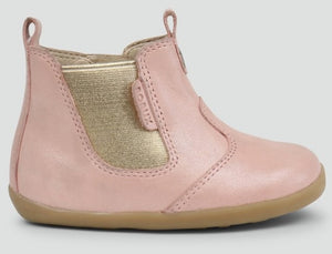 Bobux Blush Shimmer Boot. This classic jodhpur boot features a beautiful shimmery, metallic elasticated side panel with a zip closure and pull on tabs making the boot easier to get on and off.  Features:  100% leather upper and lining Zip closure and elastic gusset for a secure fit  Leather lining gives breathability  Flexible, lightweight sole