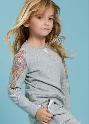 angel face sweat top in Marl/Grey with sequin wing details on arms which ombre from pink to silver. Finished with angel face charm and bow.