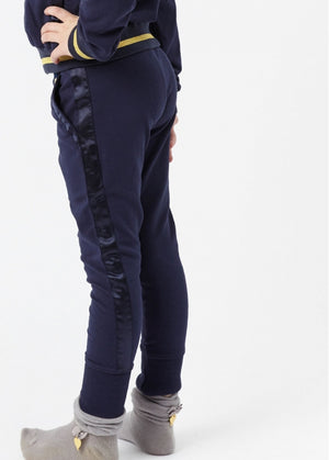 slim fit joggers made from soft stretchy cotton featuring satin trim down each leg and over pockets. Stretchy waistband with angel face charm and bow detail.