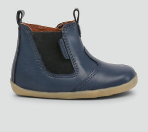 Bobux Navy Jodphur Boot. Classic jodhpur boot featuring a matching navy side elasticated panel with side zip and easy pull on tabs ensuring a secure and comfortable fit. The stylish leather makes the perfect striking addition to any outfit.  Features: 100% Leather upper and lining Zip closure making the boot both easy to put on and secure Flexible and lightweight sole