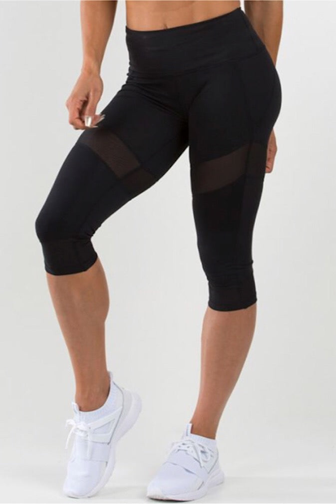 Ryderwear Black Renegade Capris, four-way stretch, mid-waist design, 3/4 length, moisture wicking, tummy tucking waistband, fitwear, fitness wear, fitness apparel, athletic wear, athletic apparel, athleisure, workout wear, activewear for women, mesh panels