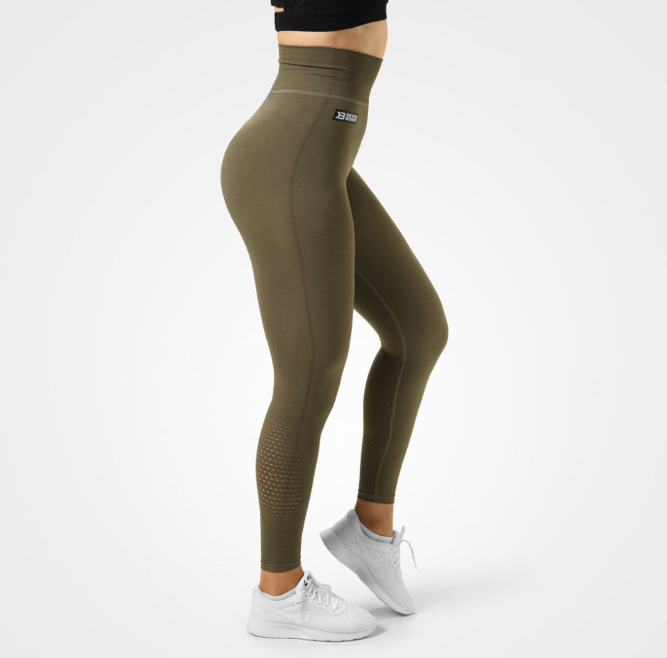 Better Bodies Bowery High Tights, Khaki Green. High waist, double folded rib waistband, knitted mesh holes on the back of the lower leg, full length, smooth and silky to the touch.