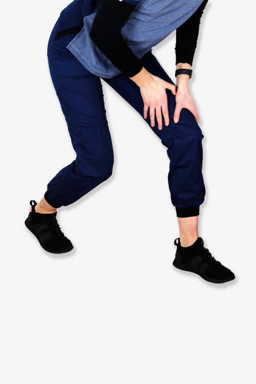 Rhino scrubs navy joggers pants girl stretching