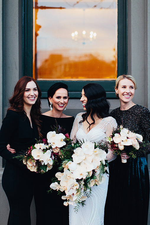 Brides and bridesmaids holding wedding flowers and bridal bouquets in Melbourne