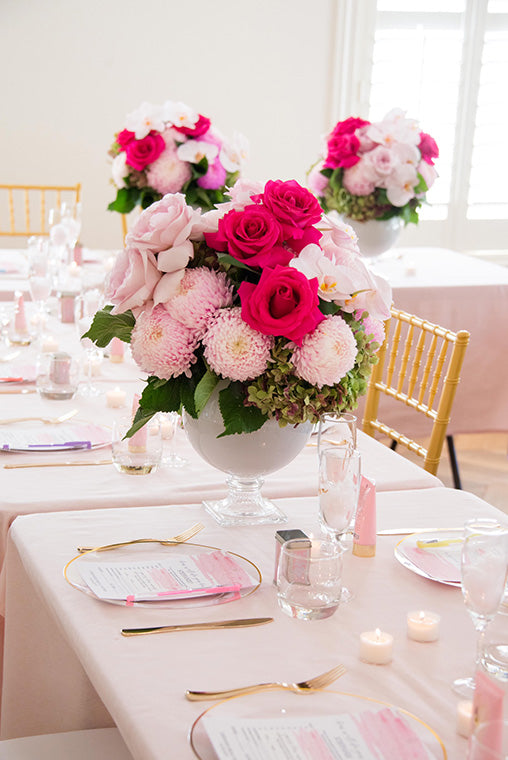 Close up of bridal shower flowers on dining table