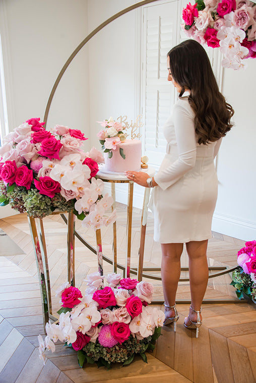Bridal to be admiring bridal flowers