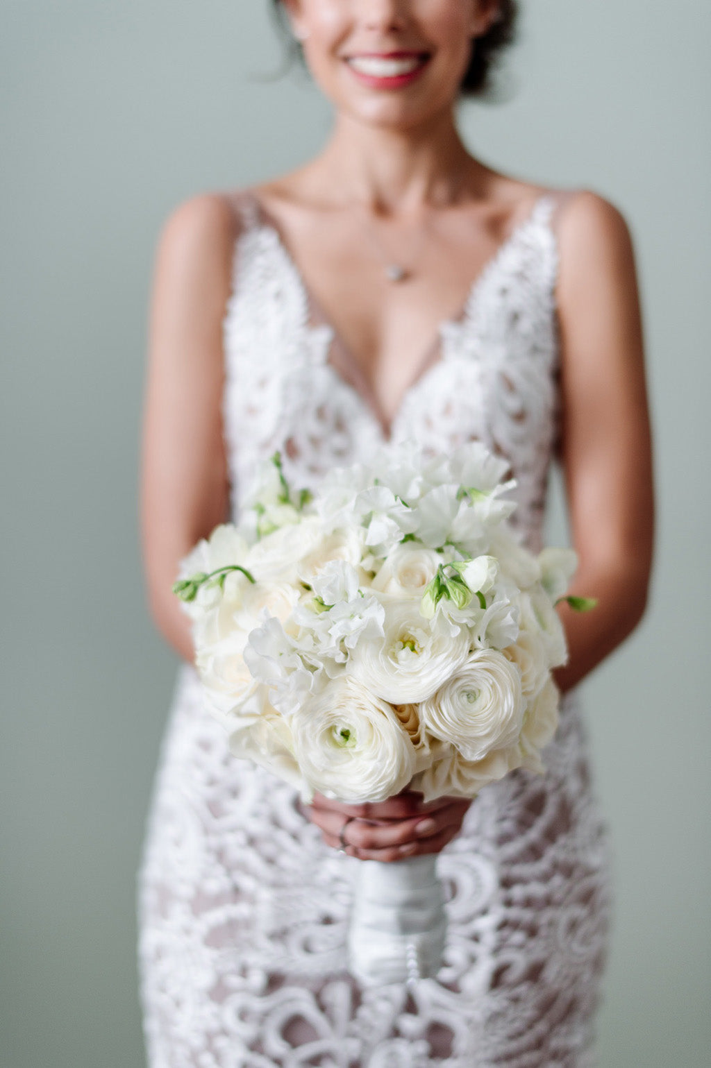 Bride holding white bridal bouquet wedding flowers