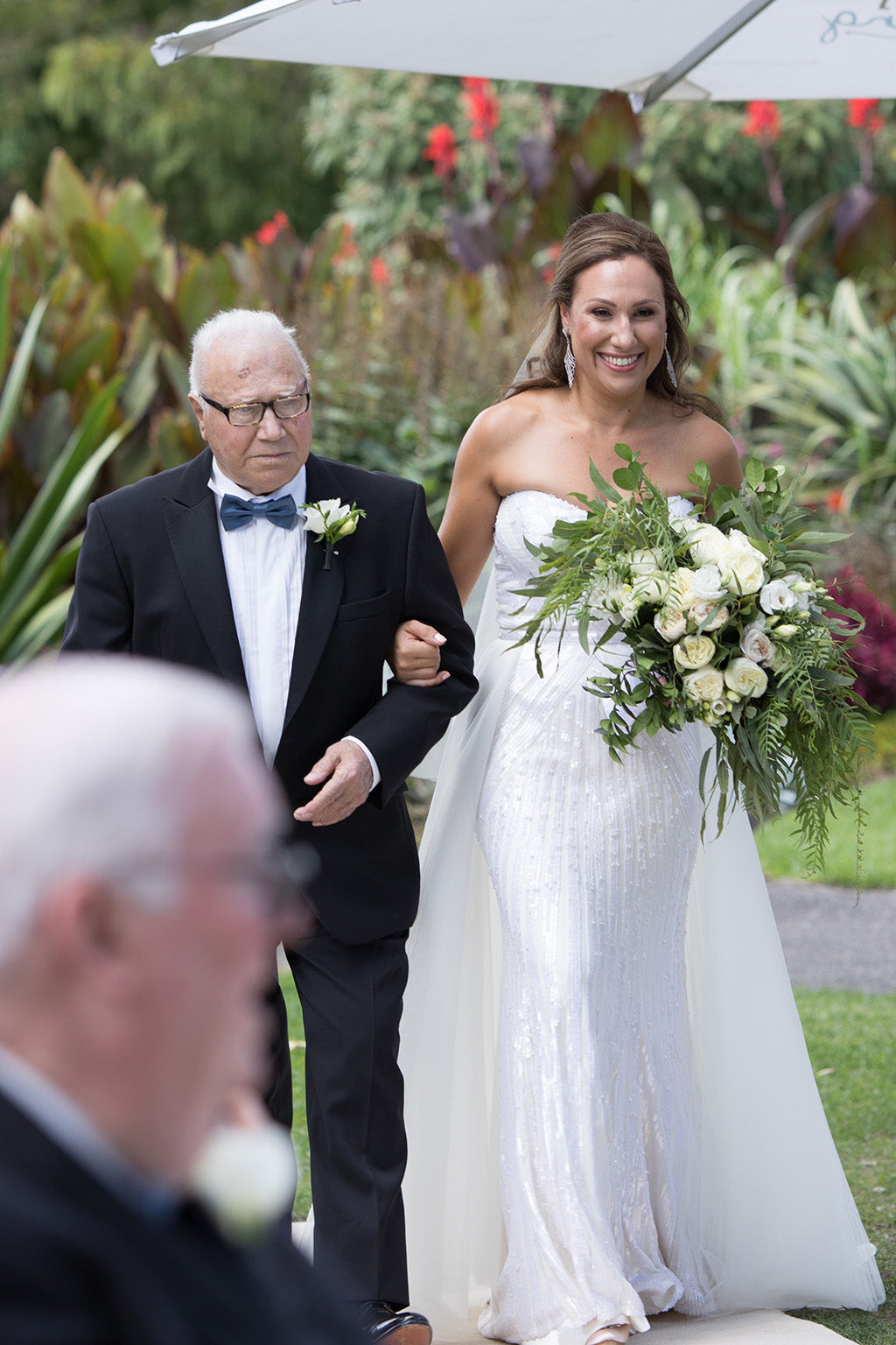 Bride walking down the isle with her father at wedding