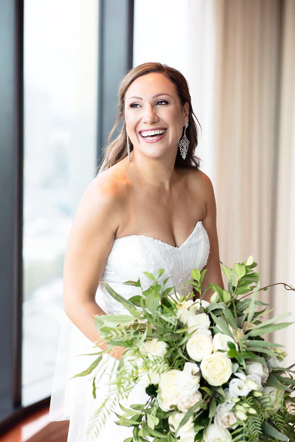 Bride with her wedding bouquet flowers