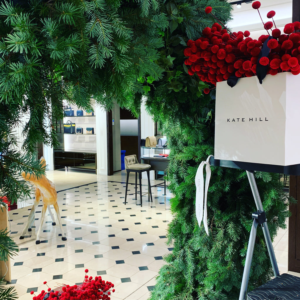 Setting up the Christmas wreath in the Burberry Melbourne store