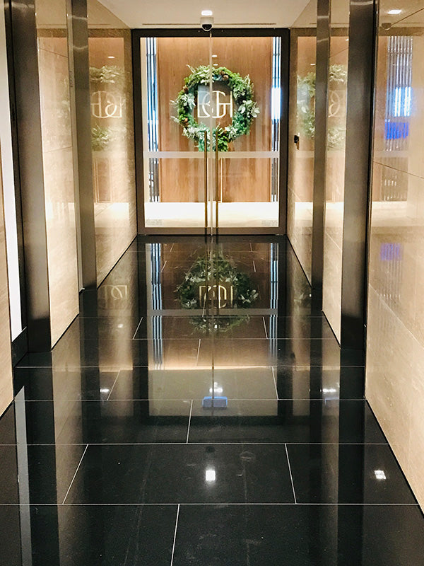 Christmas wreath in corridor of a corporate business in Melbourne
