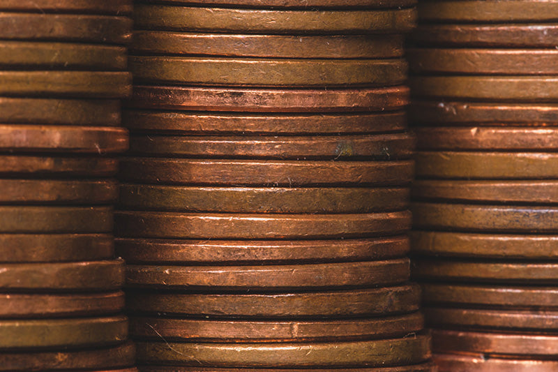 Stack of copper coins for vase
