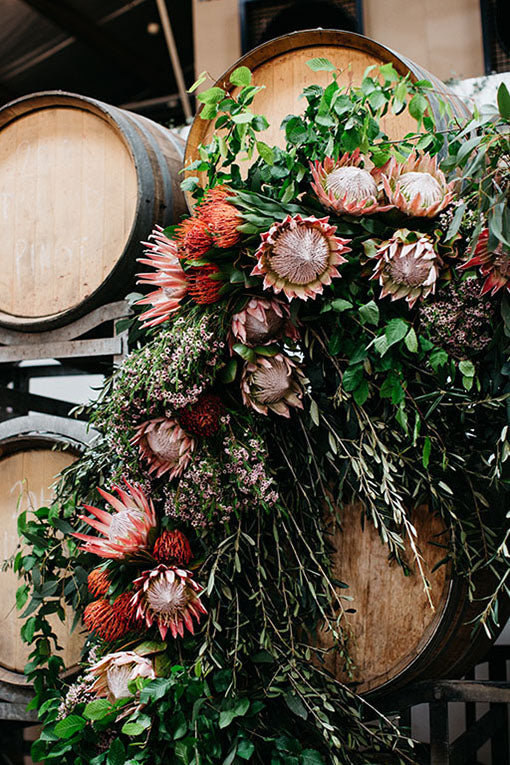 Wedding Flowers in front of barrels