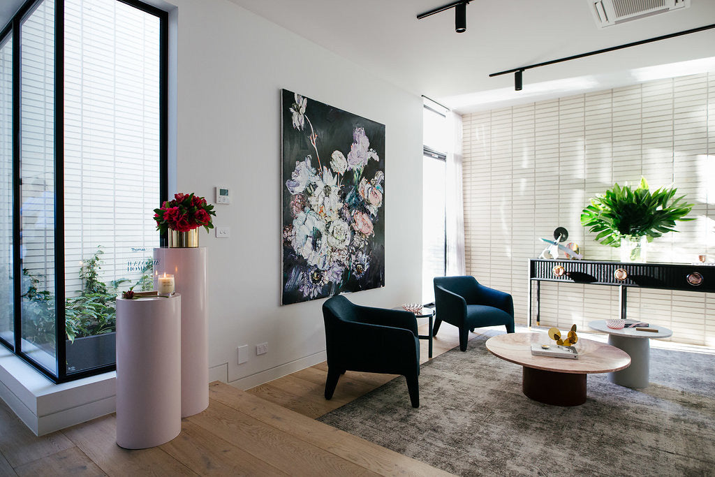 Living room setting with flowers on display