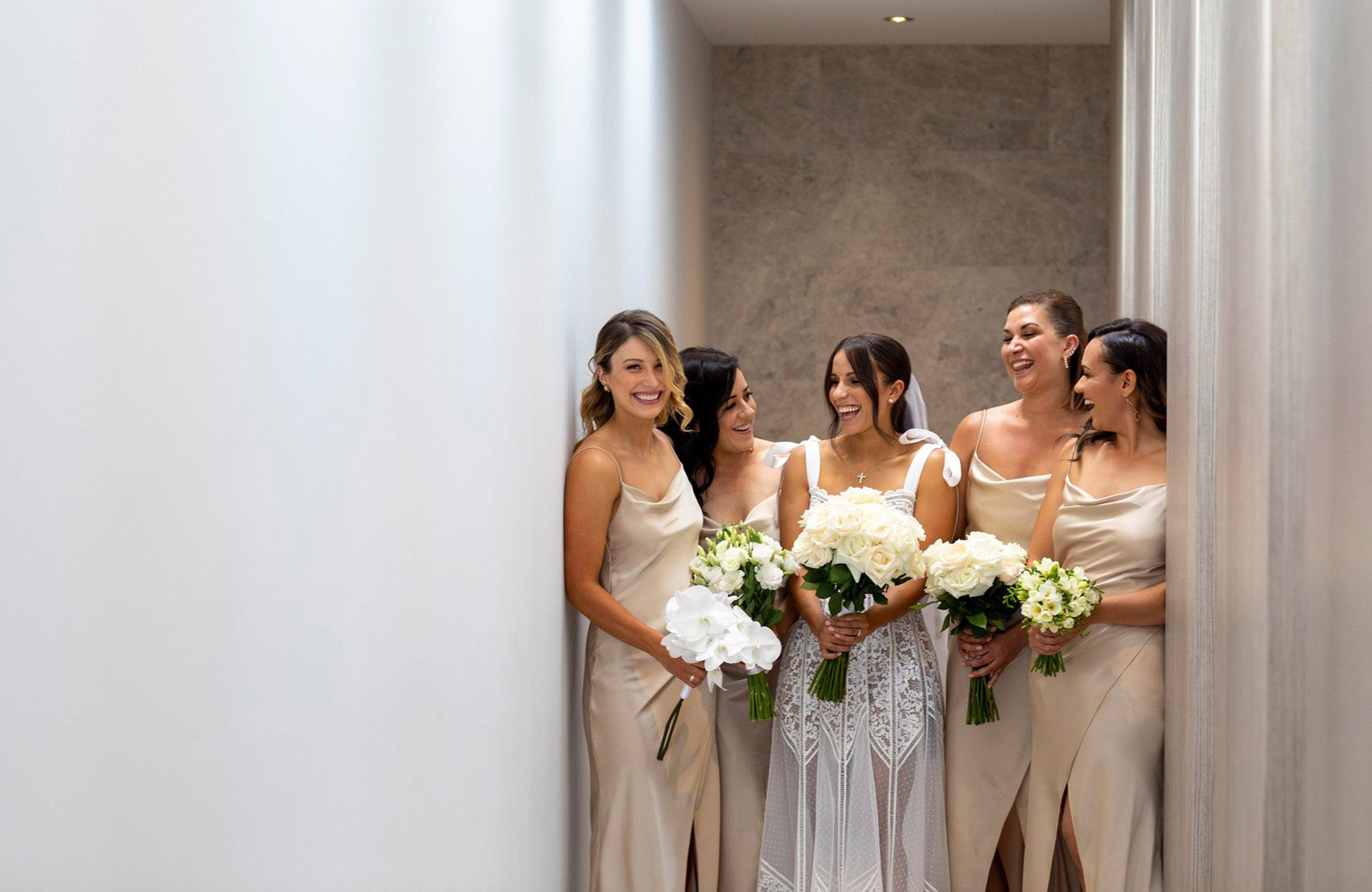 Bride and bridesmaids holding wedding flower bouquets