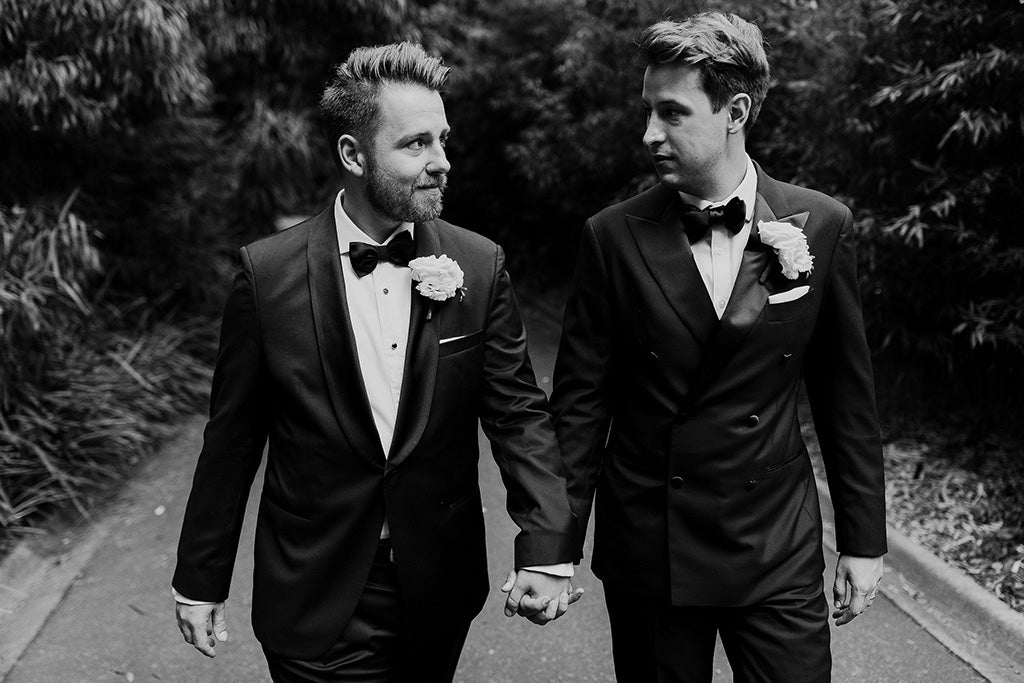 Groom and Groom walking holding hands