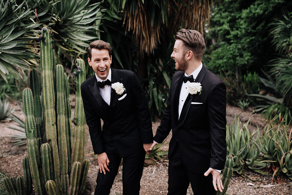 Married couple laughing at wedding in gardens