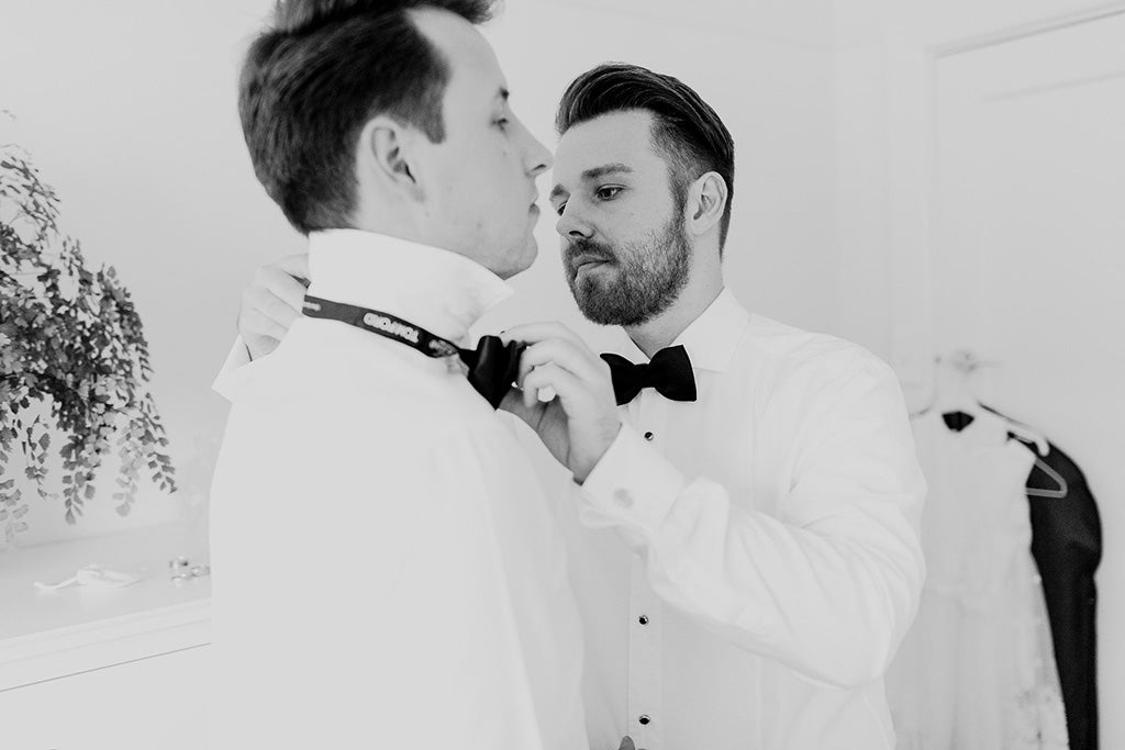 Grooms getting ready for wedding