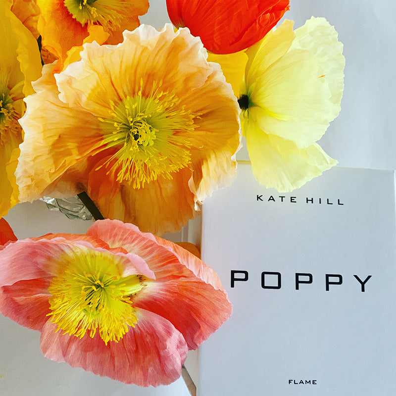 Poppy birthday flowers with candle gift