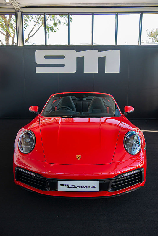 Red Porsche 911 at women with drive event