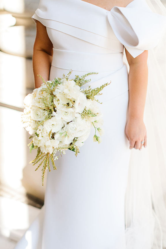 Bride holding bridal bouquet wedding flowers