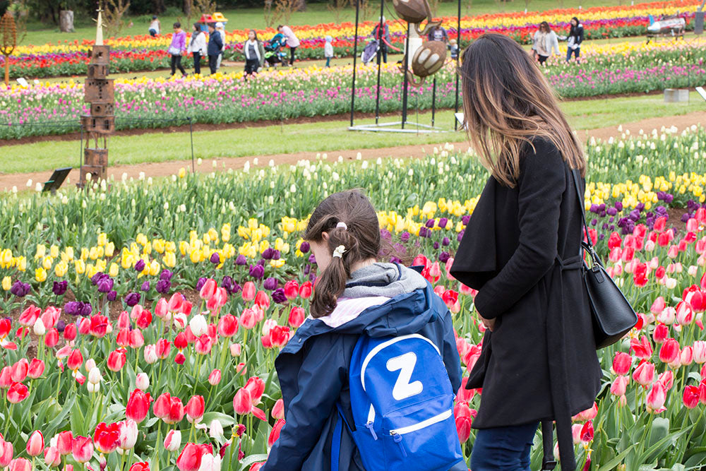 Tulip Festival Girls Looking at Flowers