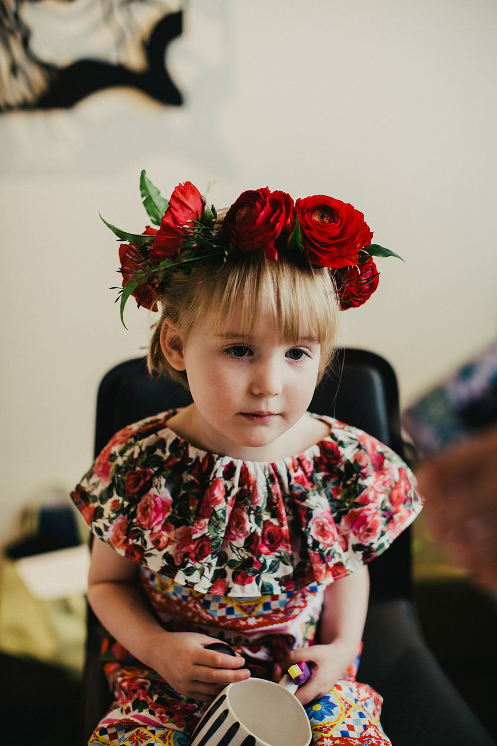 Young girl with red flower crown