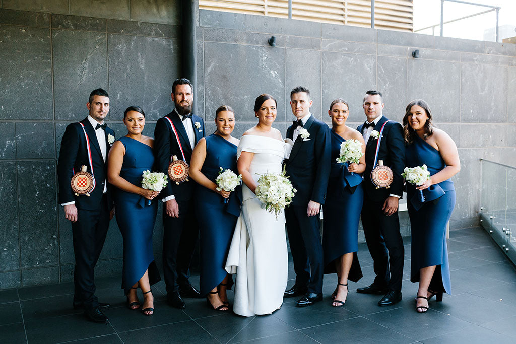 Bridal party at wedding with wedding flowers