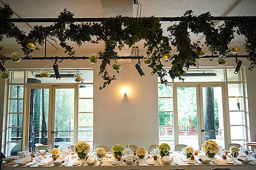 Wedding flowers table setting and hanging installation