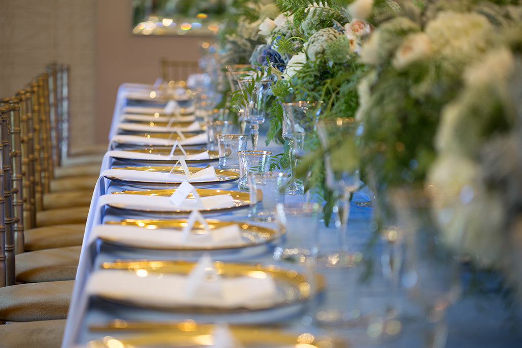 Wedding flowers decorate the table setting