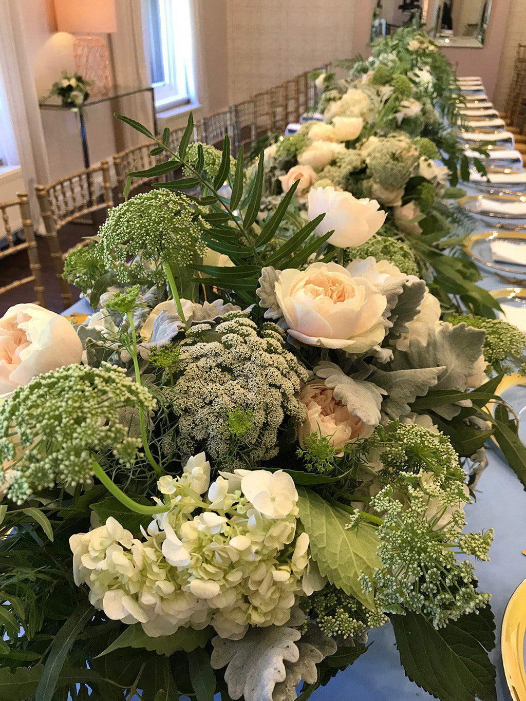 Wedding flowers at the reception table setting