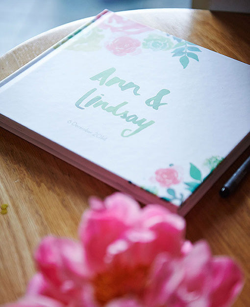 Welcome book with peony wedding flowers