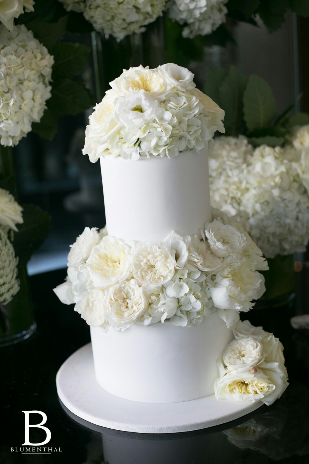 Wedding Cake Decorated with White Flowers