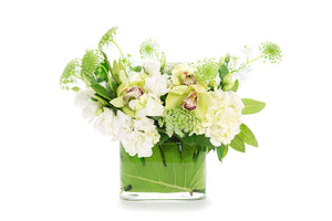 A vase flower arrangement in white and green hues seated in a clear vase lined with gymea | BAILEY Vase Flower Design | Flowers & Plants Store | Kate Hill Flowers