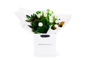 Flower bouquet featuring white tulips and lush green foliage seating in a Kate Hill Flowers gift bag | BROOKE Flower Bouquet | Flowers & Plants Store | Kate Hill Flowers