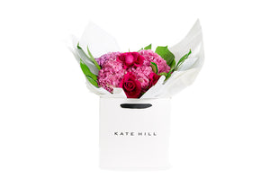Pink flower bouquet wrapped in white paper and seated in a Kate Hill Flowers gift bag | BLUSH Flower Bouquet | Flowers & Plants Store | Kate Hill Flowers