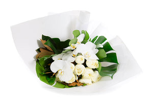 Flower bouquet featuring white flowers and green foliage