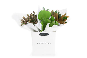 Grouping of foliages seating in a Kate Hill Flowers gift bag