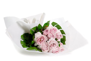 Flower bouquet featuring reflexed pink roses