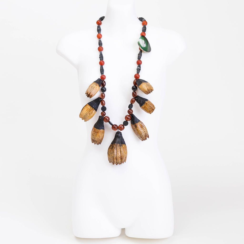Handmade necklace made from lacquered and eco dyed rice paper covered panda seed pods, bespoke and handmade canvas beads