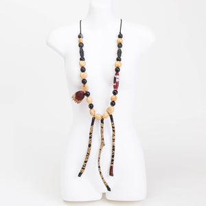 Handmade necklace made from lacquered & eco dyed rice paper covered panda seed pods, cocoa seed pods, handmade rolled canvas & wooden beads