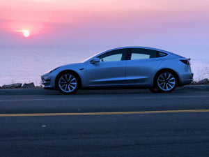 Silver Tesla Model 3 at Sunset